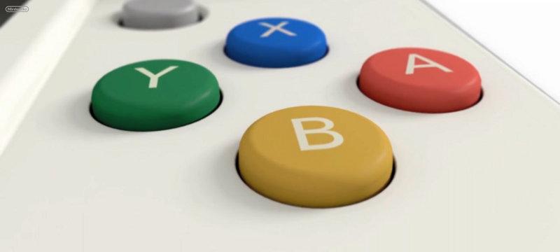 Die neuen, farbigen Buttons erinnern sehr an den Xbox-Controller. Oben ist der kleine Mini-Stick zu erkennen, der ebenfalls neu ist.